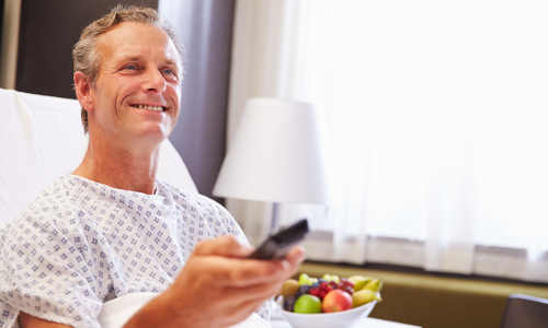 Male Patient using patient entertainment system